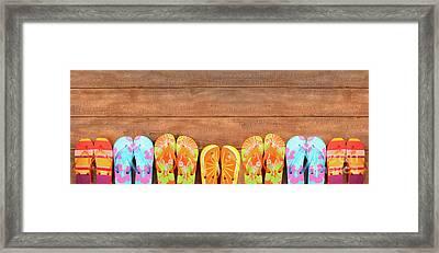 Brightly Colored Flip-flops On Wood  Framed Print by Sandra Cunningham