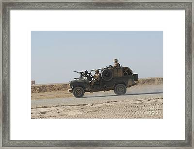 British Soldiers Patrol Afghanistan Framed Print by Andrew Chittock