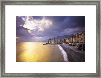 Buildings Along The Coast At Sunset Framed Print by David DuChemin
