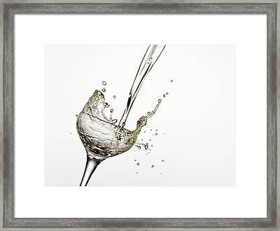 Champagne Being Poured Into Glass Framed Print