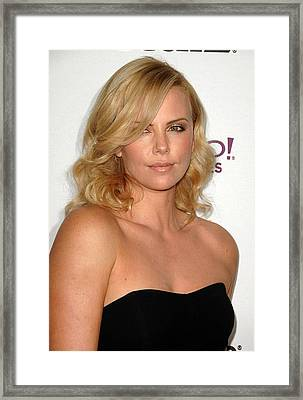 Charlize Theron At Arrivals For The Framed Print by Everett
