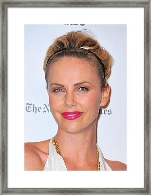 Charlize Theron Wearing A Jennifer Behr Framed Print