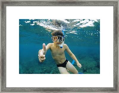Child Snorkelling Framed Print