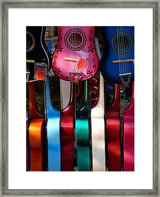 Colorful Guitars Framed Print by Jeff Lowe
