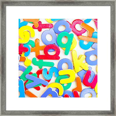 Colorful Letters Framed Print by Tom Gowanlock
