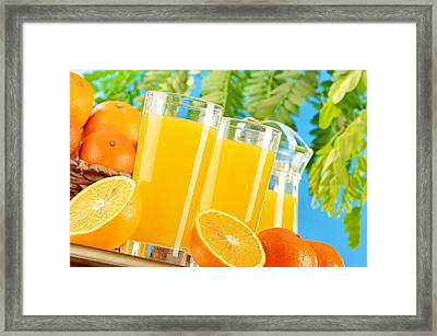 Composition With Two Glasses Of Orange Juice And Fruits Framed Print by T Monticello