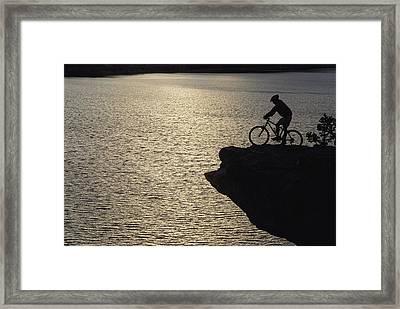 Dan Davis Takes In The View Framed Print by Bill Hatcher
