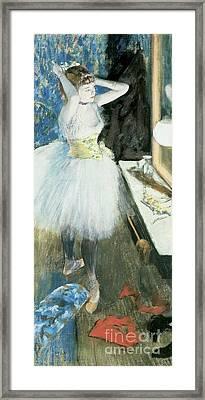 Dancer In Her Dressing Room Framed Print by Edgar Degas