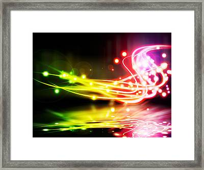 Dancing Lights Framed Print by Setsiri Silapasuwanchai