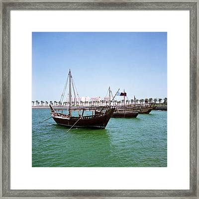Dhows In Doha Bay Framed Print by Paul Cowan