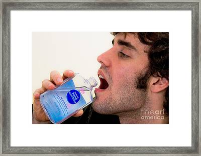 Drinking Hand Sanitizer Framed Print by Photo Researchers