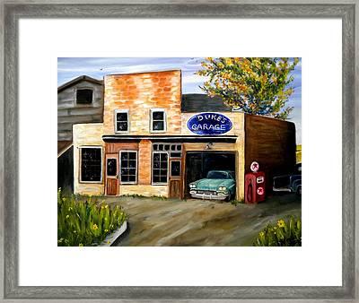 Duke's Garage Framed Print