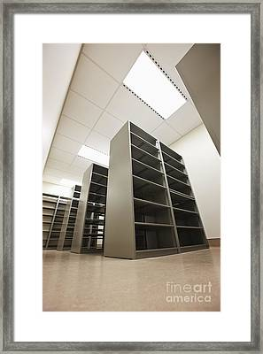 Empty Metal Shelves Framed Print by Jetta Productions, Inc
