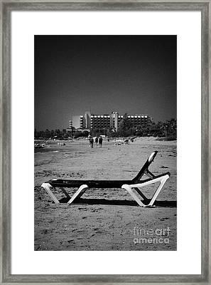 Empty Sun Lounger On Cyprus Tourist Organisation Municipal Beach In Larnaca Bay Republic Of Cyprus Framed Print