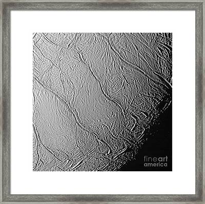 Enceladus Surface Framed Print by NASA / Science Source