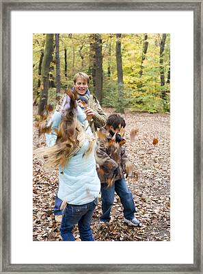 Father And Children Playing In A Wood Framed Print