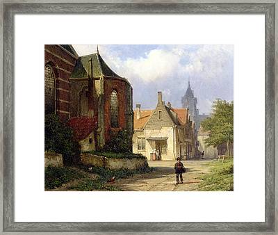 Figure Before A Redbrick Church In A Dutch Town Framed Print