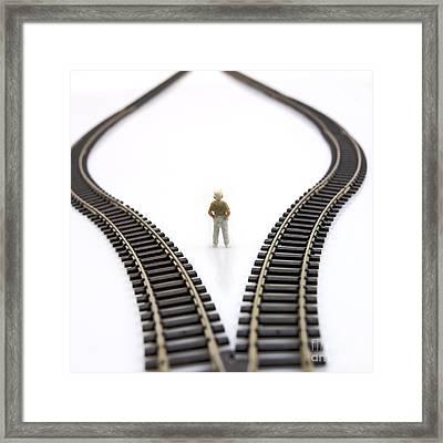 Figurine Between Two Tracks Leading Into Different Directions  Symbolic Image For Making Decisions. Framed Print
