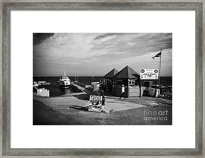 first and last shop and John OGroats harbour with orkney ferry scotland uk Framed Print by Joe Fox