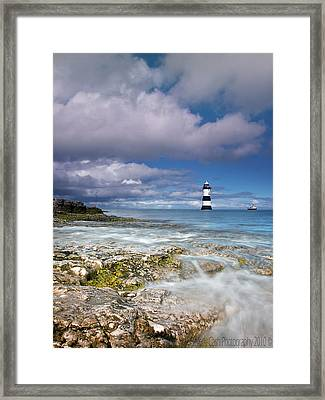 Fishing By The Lighthouse Framed Print