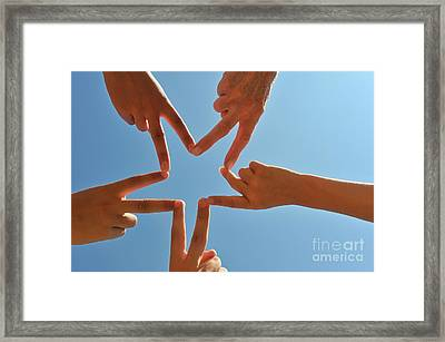 Five Hands Drawing A Star Shape Framed Print by Sami Sarkis