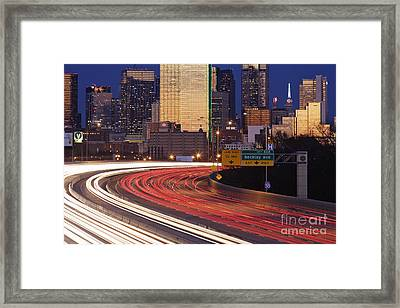 Freeway Traffic At Dusk On I-30 Framed Print by Jeremy Woodhouse
