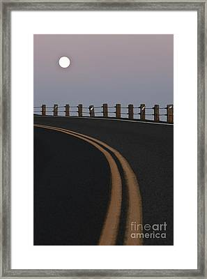Full Moon Over A Curving Road Framed Print by Jetta Productions, Inc