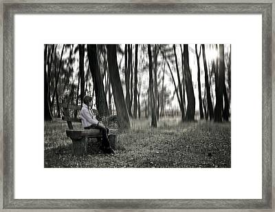Girl Sitting On A Wooden Bench In The Forest Against The Light Framed Print by Joana Kruse