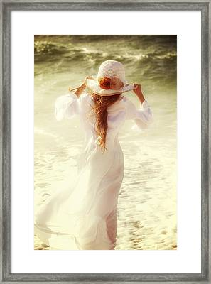 Girl With Sun Hat Framed Print