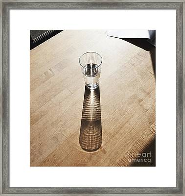 Glass Of Water On A Desk Framed Print by Jetta Productions, Inc