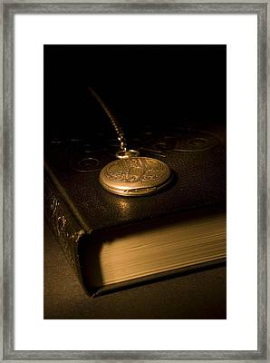 Gold Pocket Watch Resting On A Book Framed Print by Philippe Widling