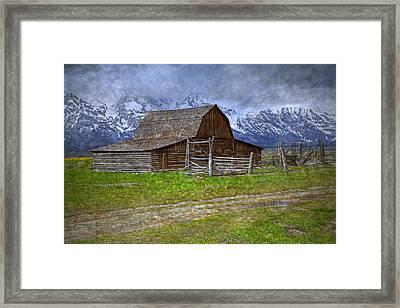 Grand Teton Iconic Mormon Barn Fence Spring Storm Clouds Framed Print by John Stephens