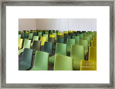 Green Chairs In A Presentation Room Framed Print by Jaak Nilson