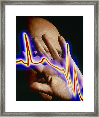 Heart Disease: Hand Held Up To Irregular Ecg Trace Framed Print by Mehau Kulyk