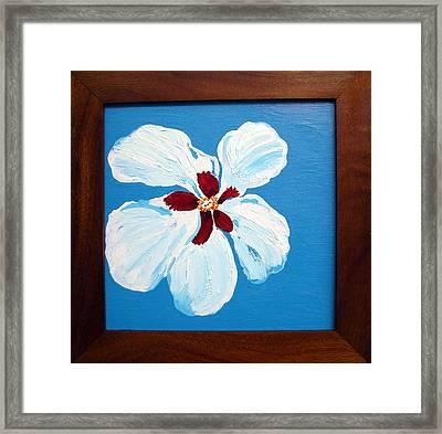 Hibiscus On Blue Framed Print by Karen Nicholson