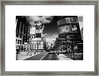 Intersection Of Yonge And Dundas At Yonge-dundas Square Toronto Ontario Canada Framed Print by Joe Fox