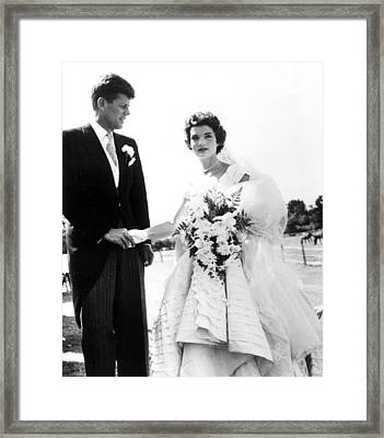 John F. Kennedy And Jacqueline Bouvier Framed Print