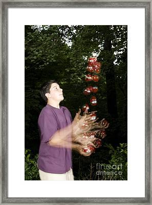 Juggling Balls Framed Print by Ted Kinsman