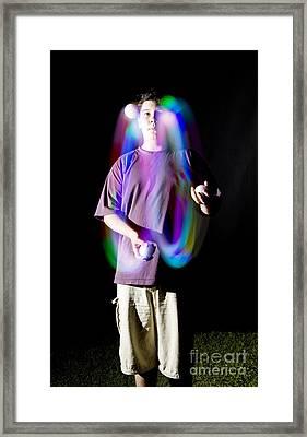 Juggling Light-up Balls Framed Print by Ted Kinsman