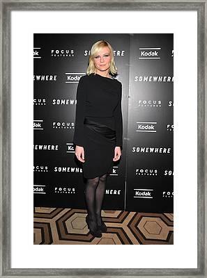 Kirsten Dunst At Arrivals For Somewhere Framed Print by Everett
