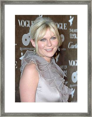 Kirsten Dunst Wearing A Valentino Gown Framed Print