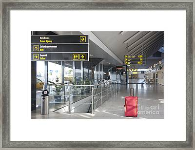 Luggage Sitting Alone In An Airport Terminal Framed Print
