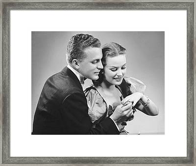 Man Putting Ring On Woman's Finger Framed Print by George Marks