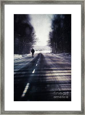 Man Walking On A Rural Winter Road Framed Print by Sandra Cunningham