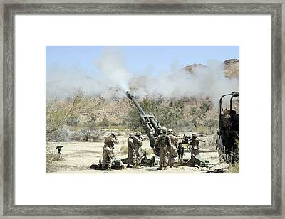 Marines Shoot 100-pound Rounds Framed Print by Stocktrek Images