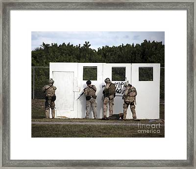 Military Reserve Members Prepare Framed Print by Michael Wood
