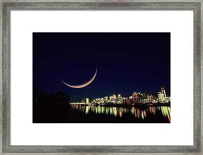 Moon Over Vancouver Framed Print by David Nunuk