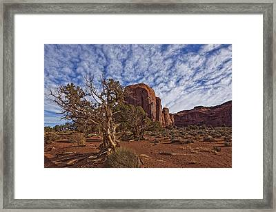 Morning Clouds Over Monument Valley Framed Print by Robert Postma