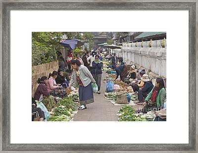 Morning Market In Luang Prabang Framed Print by Roberto Morgenthaler