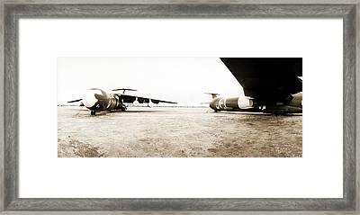 Mothballed C-141s Framed Print by Jan W Faul